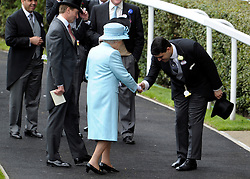 © Licensed to London News Pictures. 19/06/2012. Ascot, UK  HRH Queen Elizabeth II is received at the Parade Circle. Day one at Royal Ascot 19 June 2012. Royal Ascot has established itself as a national institution and the centrepiece of the British social calendar as well as being a stage for the best racehorses in the world.. Photo credit : Stephen Simpson/LNP
