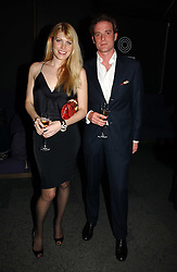 MEREDITH OSTROM and RICCARDO LANZA at a party to launch Three's A Crowd held at the Mayfair Hotel, Berkley Street, London on 5th December 2006.<br />