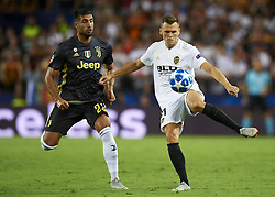 September 19, 2018 - Valencia, Spain - Denis Cheryshev goes passed front to Emre Can during the Group H match of the UEFA Champions League between Valencia CF and Juventus at Mestalla Stadium on September 19, 2018 in Valencia, Spain. (Credit Image: © Jose Breton/NurPhoto/ZUMA Press)