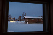 The full moon as seen through a window in the early morning hours, Nenana, Alaska