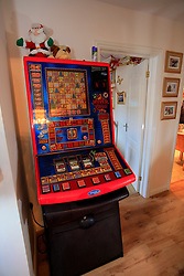 UK ENGLAND WILTSHIRE MELKSHAM 17DEC09 - Game machine at Andy Park's house in Melksham, Wiltshire, where the self-proclaimed Mr Christmas celebrates Christmas every day. Mr Park, a 45-year-old divorced electrician, has consumed nearly 118,000 brussel sprouts and about 5000 bottles of Moet champagne since he decided to get into the festive spirit full-time in July 1994...jre/Photo by Jiri Rezac..© Jiri Rezac 2009