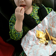 Holly Larue Frizzelle, 2, eats a meal after a sedation appointment at the UNC Cancer Hospital in January 2013. For sedation appointments Larue is not allowed to eat after midnight before appointment. On December 27, 2012 two year old Holly Larue Frizzelle was diagnosed with Acute Lymphoblastic Leukemia. What began as a stomach ache and visit to her regular pediatrician led to a hospital admission, transport to the University of North Carolina Children's Hospital, and more than two years of treatment.