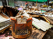 16 NOVEMBER 2015 - BANGKOK, THAILAND:  An old charcoal cooking pot in a demolished home in the Wat Kalayanamit neighborhood. Fifty-four homes around Wat Kalayanamit, a historic Buddhist temple on the Chao Phraya River in the Thonburi section of Bangkok, are being razed and the residents evicted to make way for new development at the temple. The abbot of the temple said he was evicting the residents, who have lived on the temple grounds for generations, because their homes are unsafe and because he wants to improve the temple grounds. The evictions are a part of a Bangkok trend, especially along the Chao Phraya River and BTS light rail lines. Low income people are being evicted from their long time homes to make way for urban renewal.          PHOTO BY JACK KURTZ