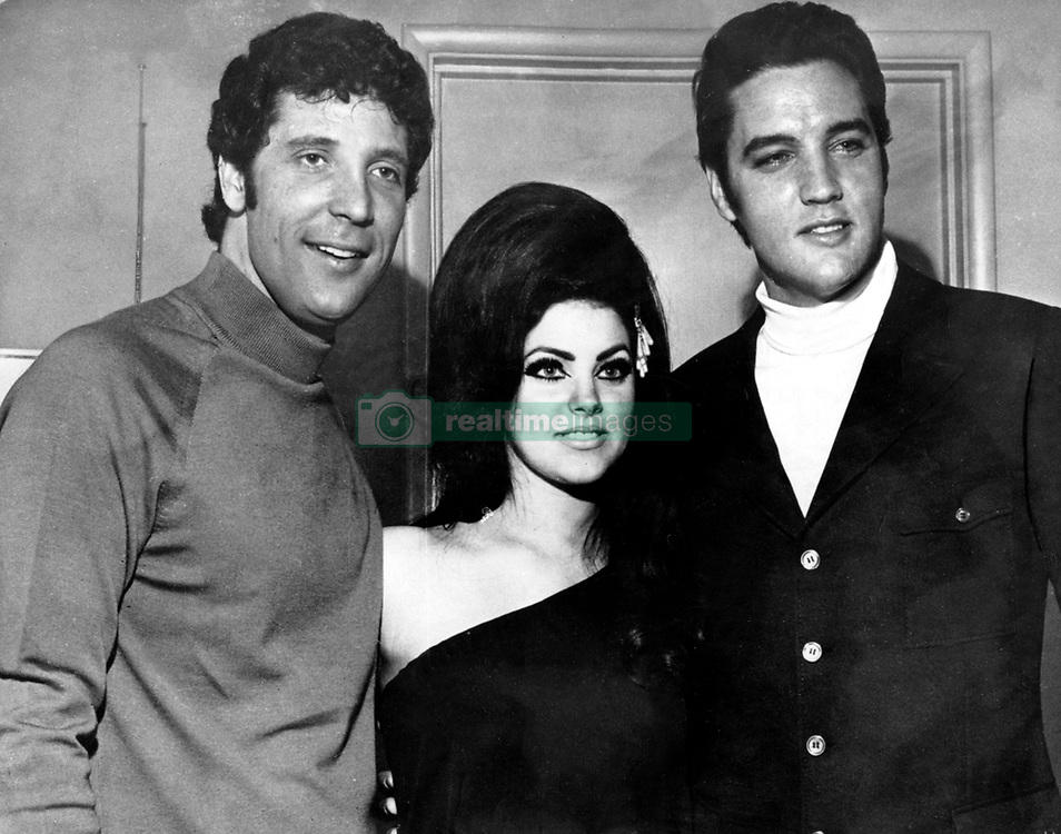 Jan. 1, 1970 - Los Angeles, CA, U.S. - British musician TOM JONES, ELVIS PRESLEY with his wife PRISCILLA BEAULIEU. A white southerner who singing blues laced with country and country tinged with gospel, Presley brought together music from both sides of the color line. Presley performed this music with a natural hip swiveling sexuality that made him a teen idol. (Credit Image: © Keystone Press Agency/Keystone USA via ZUMAPRESS.com)