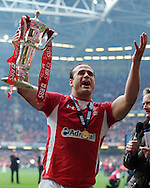 Jamie Roberts of Wales celebrates with the trophy after the win. RBS Six nations champs 2012, Wales v France at the Millennium Stadium in Cardiff, South Wales on Saturday 17th March 2012.  pic by Andrew Orchard, Andrew Orchard sports photography,