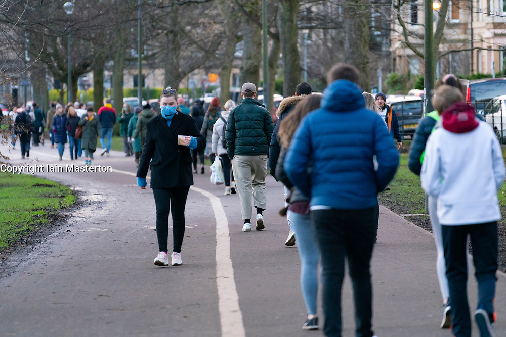 Edinburgh, Scotland, UK. 17 January 2020. On first Sunday after tightening of national lockdown rules in Scotland the public were out in large numbers in The Meadows park in Edinburgh. Very little social distancing was maintained between walkers, joggers and cyclists as they  competed for space on a narrow footpath.  Iain Masterton/Alamy Live News