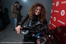 "EICMA's Ela Dutch at the ""Live the Night Faster"" party hosted by Yamaha at the Officine del Volo during EICMA, the largest international motorcycle exhibition in the world. Milan, Italy. November 17, 2015.  Photography ©2015 Michael Lichter."