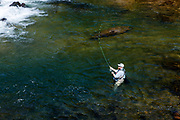 Man fly fishing for trout in the Chattahoochee River, White County, Georgia, USA.