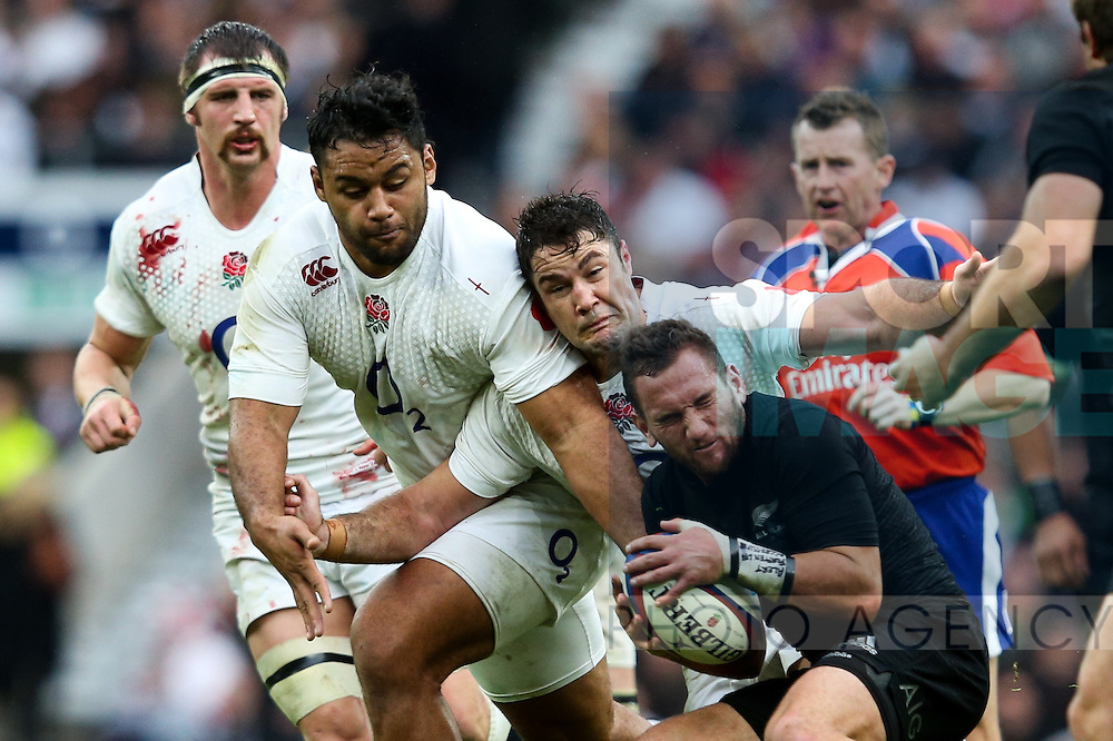England's Biily Vunipola, England's Brad Barritt and New Zealand's Aaron Smith - QBE Autumn Internationals - England vs New Zealand - Twickenham Stadium - London - 08/11/2014 - Pic Charlie Forgham-Bailey/Sportimage