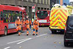 Ladbroke Grove, London, November 17th 2016. A double decker bus crashes into Kensal House on Ladbroke Grove prompting a major response from the emergency services including the air ambulance. According to Detective Chief Superintendent Ellie O'Connor of Met Police Kensington and Chelsea, 14 people including the driver were hurt, with none sustaining life-threatening or life changing injuries. Police officers would not speculate on the cause of the accident, but apologised for delays and commended all branches of the emergency services for their prompt and efficient response. The bus will be towed away for further investigations. PICTURED: Air ambulance crew walk through the scene.
