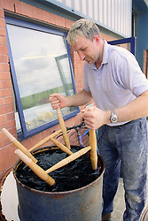 Man with learning disability staining pine chair,