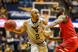 Feb 26, 2018; Morgantown, WV, USA; West Virginia Mountaineers guard Jevon Carter (2) passes the ball during the second half against the Texas Tech Red Raiders at WVU Coliseum. Mandatory Credit: Ben Queen-USA TODAY Sports