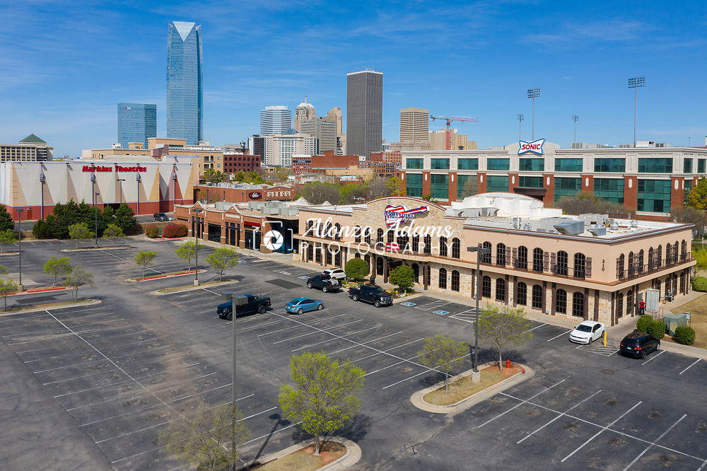An aeiral photo of an empty parking lot at lunchtime near downtown Oklahoma City following an order from the Mayor and Governor to close all non-essentail businesses due to the spread of COVID-19 on Wednesday, March 25, 2020. Photo copyright © 2020 Alonzo J. Adams.