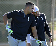 GLENDALE, ARIZONA - FEBRUARY 19: Jose Abreu #79 (L) and Yoan Moncada #10 of the Chicago White Sox look on during spring training workouts on February 19, 2019 at Camelback Ranch in Glendale Arizona.  (Photo by Ron Vesely). Subject:   Jose Abreu; Yoan Moncada