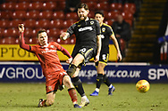 AFC Wimbledon defender Paul Kalambayi (30) gets tackled during the EFL Sky Bet League 1 match between Walsall and AFC Wimbledon at the Banks's Stadium, Walsall, England on 12 February 2019.