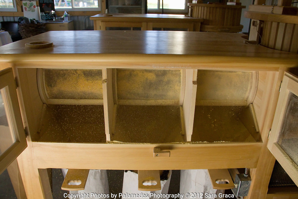 The wood mill has three sifting compartments that separate the milled corn into flour, cornmeal, and polenta.