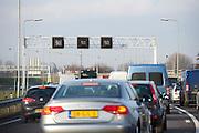 File voor de van Brienenoordbrug op de A16 richting afslag Capelle aan den IJssel.File on the highway A16 near Rotterdam