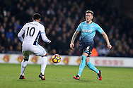 Alfie Mawson of Swansea city (r) in action. Premier league match, West Bromwich Albion v Swansea city at the Hawthorns stadium in West Bromwich, Midlands on Wednesday 14th December 2016. pic by Andrew Orchard, Andrew Orchard sports photography.