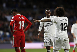 January 24, 2019 - Madrid, Madrid, Spain - Vinicius Jr (Real Madrid) and Marcelo (Real Madrid) are seen talking during the Copa del Rey Round of quarter-final first leg match between Real Madrid CF and Girona FC at the Santiago Bernabeu Stadium in Madrid, Spain. (Credit Image: © Manu Reino/SOPA Images via ZUMA Wire)