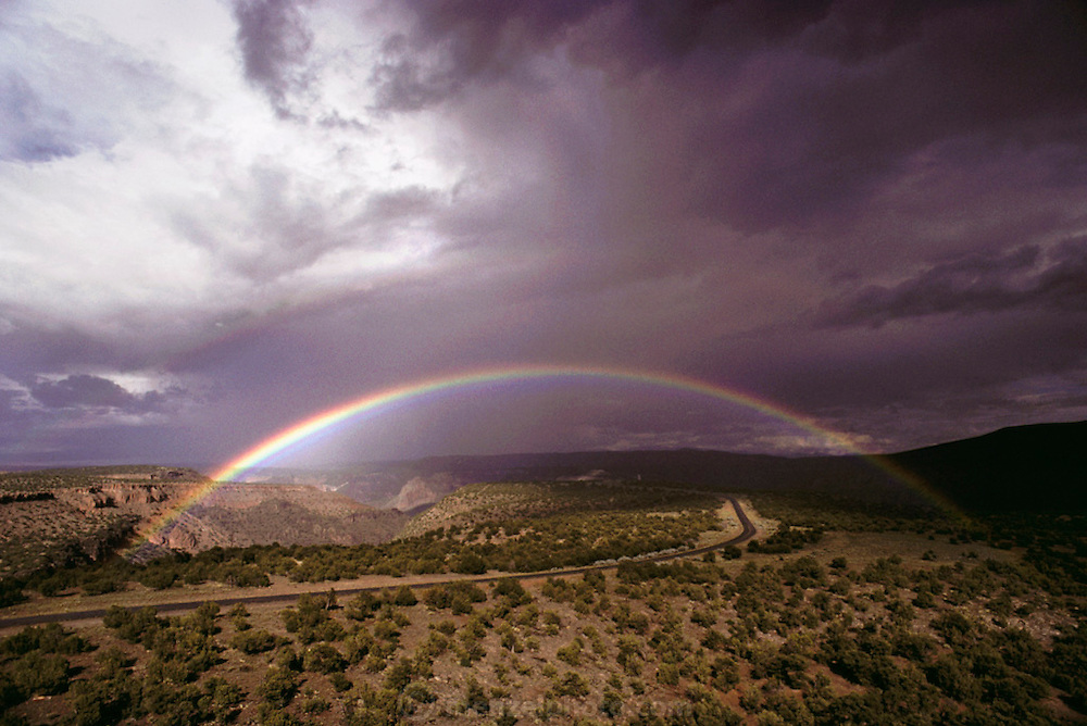 Weather: Rainbow, Rio Grande Valley, Los Alamos, New Mexico. Rainbows occur when the observer is facing falling rain but with the sun behind them. White light is reflected inside the raindrops and split into its component colors by refraction. (1988)