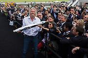 Richard Branson shows spectators a model of satellite LauncherOne after Virgin Galactic space tourism presentation at Farnborough