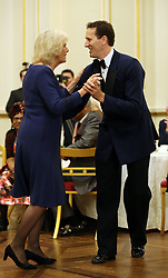December 23, 2017 - London, London, United Kingdom - Image licensed to i-Images Picture Agency. 22/12/2017. London, United Kingdom. The Duchess of Cornwall, President of the National Osteoporosis Society, dances with Strictly Come Dancing professional dancer Brendan Cole as she hosts a tea dance at Buckingham Palace in London to highlight the benefits for older people of staying active. (Credit Image: © Rota/i-Images via ZUMA Press)