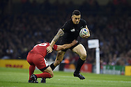 Sonny Bill Williams of New Zealand breaks away from Victor Kolelishvili of Georgia. Rugby World Cup 2015 pool c match, New Zealand v Georgia at the Millennium Stadium in Cardiff, South Wales  on Friday 2nd October 2015.<br /> pic by  Andrew Orchard, Andrew Orchard sports photography.