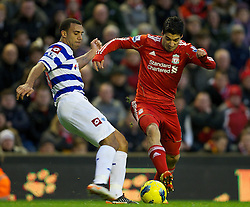 10.12.2011, Anfield Stadion, Liverpool, ENG, PL, FC Liverpool vs Queens Park Rangers, 15. Spieltag, im Bild Liverpool's Luis Alberto Suarez Diaz in action against Queens Park Rangers' Anton Ferdinand during the Premiership match at Anfield the football match of English premier league, 15th round, between FC Liverpool and Queens Park Rangers at Anfield Stadium, Liverpool, United Kingdom on 2011/12/10. EXPA Pictures © 2011, PhotoCredit: EXPA/ Propagandaphoto/ David Rawcliff..***** ATTENTION - OUT OF ENG, GBR, UK *****