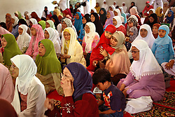 A young girl is comforted by her mother during  the mass circumcision event timed to honor the Prophet Mohammed's birthday in Bandung, Indonesia on April 23, 2006. All the girls were circumcised in years prior. The families of 248 girls were given money to have their children circumcised at this event. While religion was the main reason for circumcisions, it is believed by some locals that a girl who is not circumcised would have unclean genitals after she urinates which could lead to cervical cancer. It is also believed if one prays with unclean genitals their prayer won't be heard. The practitioners used scissors to cut the hood and tip of the clitoris. The World Health Organization has deemed the ritual unnecessary and condemns such practices.