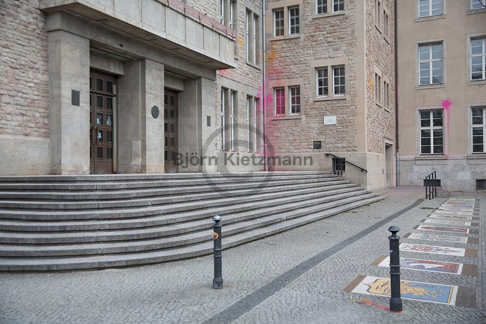 Berlin, Germany - 11.01.2015<br /> <br /> Damage to the Berlin-Neukoelln town hall. Political damage to property in Berlin-Neukoelln. During the night, about 30-50 masked people threw in more than 50 windows, smashed paint bags and sprayed political slogans. The target of the attack was in particular the building of the district court, the town hall Neukoelln as well as a branch of Commerzbank. Other targets were the Neukoelln-Akkarden shopping mall and at a Lidl branch. The reason for the attack is apparently the death of Oury Jalloh, who was burned 10 years ago in Dessau police custody.  <br /> <br /> Schaeden am Rathaus Berlin-Neukoelln. Politische Sachbeschädigungen in Berlin-Neukoelln. Rund 30-50 Vermummte haben in der Nacht über 50 Scheiben eingeschlagen Farbbeutel geworfen und politische Parolen gesprueht. Ziel des Anschlags waren insbesondere das Amtsgerichtsgebaeude, das Rathaus-Neukoelln sowie eine Filiale der Commerzbank. Weitere Scheiben gingen an der Shoppingmall Neukoelln-Akkarden und an einer Lidl-Filiale zu Bruch. Grund für den Angriff ist offenbar der Tod von Oury Jalloh, der vor 10 Jahren in Dessauer Polizeigewahrsam verbrannte.  <br /> <br /> Photo: Bjoern Kietzmann