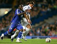 Photo: Tom Dulat.<br /> Chelsea v Shalke 04. Group B, UEFA Champions League. 24/10/2007.<br /> Marcelo Bordon of Shalke 04 and Michael Essien of Chelsea with the ball.