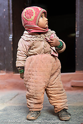 Nepalese baby in Marpha on day-6 of our Himalayan Heroes adventure riding from Muktinath to Tatopani, Nepal. Sunday, November 11, 2018. Photography ©2018 Michael Lichter.