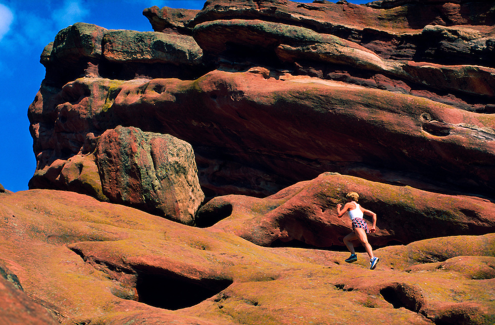Woman running at Red Rocks Park, Morrison, Colorado USA