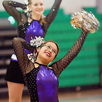 032813       Brian Leddy<br /> Gallup Catholic Cheer Team athlete Mary Canete performs for family and friends Thursday at the school. The team recently won the state championship in their division.