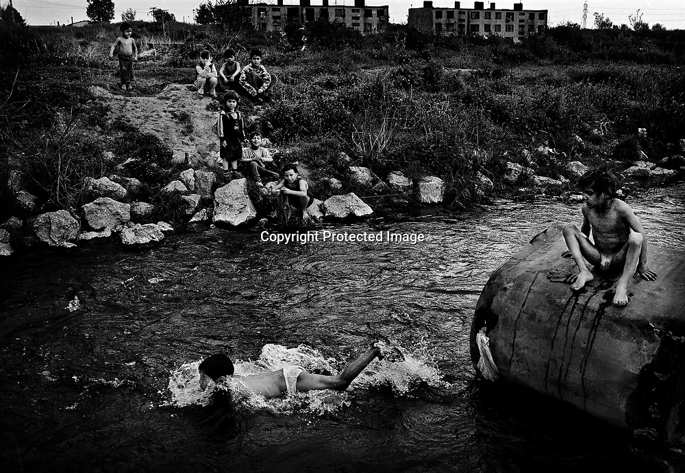 Children swimming in the nearby river of the ghetto.