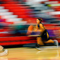 010314  Adron Gardner/Independent<br /> <br />  Kirtland Central Bronco Deandra Smith (11) is a blur of motion in Grants Friday.