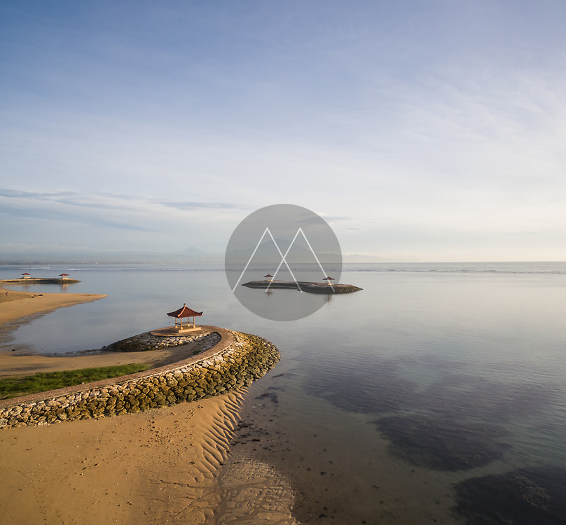 Aerial abstract view of man made coastal stone formation with pagoda and seascape,Pantai Karang, Bali.