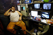 Mark Frances, 33, the control operator at the Coal Washery, a section of the Coal Processing Plant at Tower Colliery,the last deep mine in Wales, is portrayed in the control room on Tuesday, June 19, 2007, in Hirwaun, Vale of Neath, South Wales. The time is ripe again for an unexpected revival of the coal industry in the Vale of Neath due to the increasing prize and diminishing reserves of oil and gas, the uncertainties of renewable energy sources, and the technological advancement in producing energy from coal while limiting emissions of pollutants, has created the basis for valuable investment opportunities and a possible alternative to the latest energy crisis. Unity Mine, in particular, has started a pioneering effort to revive the coal industry in the area, reopening after more than 8 years with the intent of exploiting the large resources still buried underground. Coal could be then answer to both, access to cheaper and paradoxically greener energy and a better and safer choice than nuclear energy as a major supply for the decades to come. It is estimated that coal reserves in Wales amount to over 250 million tonnes, or the equivalent of at least 50 years of energy supply, while the worldwide total coal could last for over 200 years as a viable resource compared to only a few decades of oil and natural gas.