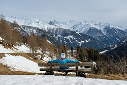 THEMENBILD - Eine Frau sitz auf einer Bank und geniest den Panoramablick über das Kalsertal und die Gipfel der Schobergruppe, am Montag, 5. April 2021 // A woman sits on a bench and enjoys the panoramic view over the Kalsertal and the peaks of the Schobergruppe, on Monday, April 5, 2021. Kals, Austria. EXPA Pictures © 2021, PhotoCredit: EXPA/ Johann Groder