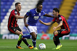 Birmingham City's Jacques Maghoma (centre) battles for the ball against AFC Bournemouth's Adam Smith (right) during the Carabao Cup, Second Round match at St Andrew's, Birmingham.