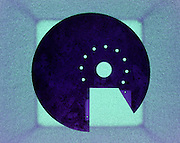 circular form on top of a square photographic impression