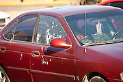 Mexican Army Soldiers respond to a assignation along a main road in Juarez, Mexico January 16, 2009 moments after armed gunman shot dead a former police officer during morning rush hour. The shooting, believed linked to the ongoing drug war which has already claimed more than 40 people since the start of the year. More than 1600 people were killed in Juarez in 2008, making Juarez the most violent city in Mexico.    (Photo by Richard Ellis)