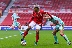 Lyle Taylor of Nottingham Forest holds off Ryan Bennett of Swansea City  - Mandatory by-line: Nick Browning/JMP - 29/11/2020 - FOOTBALL - The City Ground - Nottingham, England - Nottingham Forest v Swansea City - Sky Bet Championship