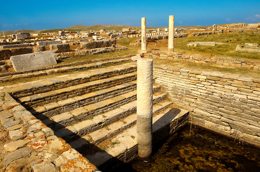 The Minoan Fountain in the ruins of the Greek city of Delos, the birthplace of the twin gods Apollo and Artemis. Greek Cyclades Islands. .<br /> <br /> Visit our GREEK HISTORIC PLACES PHOTO COLLECTIONS for more photos to download or buy as wall art prints https://funkystock.photoshelter.com/gallery-collection/Pictures-Images-of-Greece-Photos-of-Greek-Historic-Landmark-Sites/C0000w6e8OkknEb8<br /> .<br /> Visit our ANCIENT GREEKS PHOTO COLLECTIONS for more photos to download or buy as wall art prints https://funkystock.photoshelter.com/gallery-collection/Ancient-Greeks-Art-Artefacts-Antiquities-Historic-Sites/C00004CnMmq_Xllw