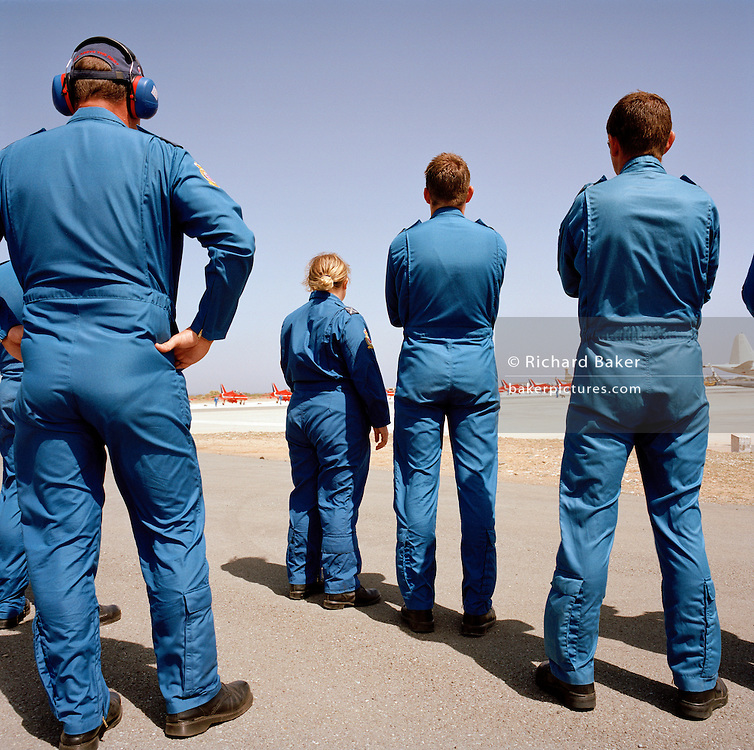 Blues ground staff wait for theRed Arrows, Britain's RAF aerobatic team to taxi out for their next air display.