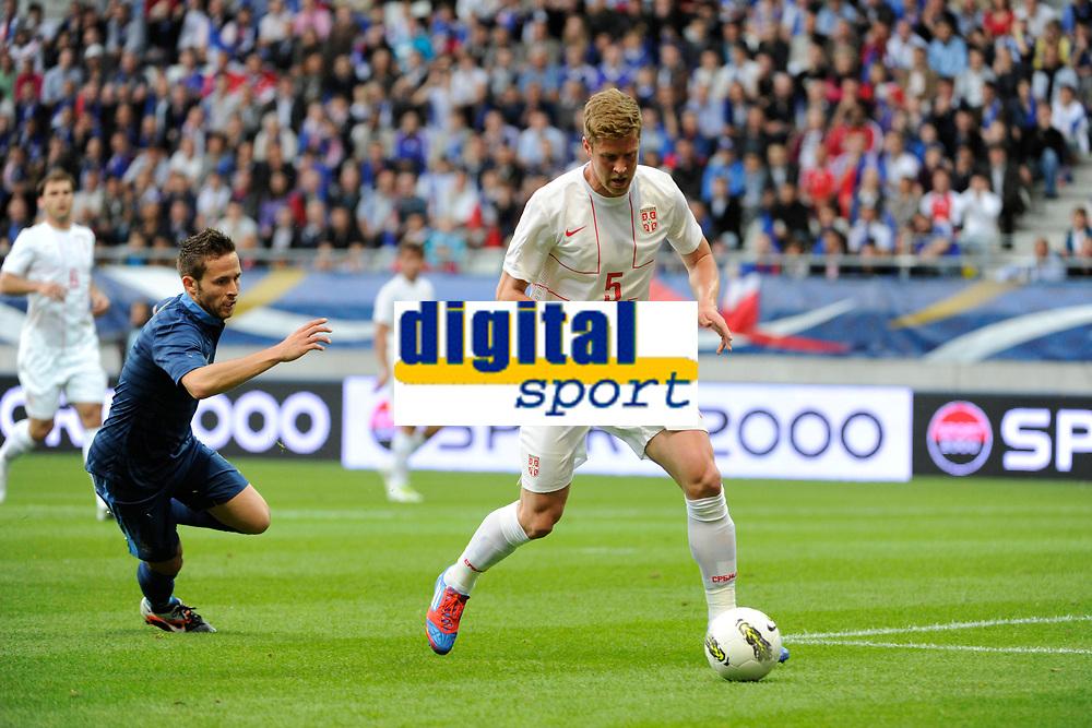 FOOTBALL - FRIENDLY GAME 2012 - FRANCE v SERBIA - REIMS (FRANCE) - 31/05/2012 - PHOTO JEAN MARIE HERVIO / REGAMEDIA / DPPI - SLOBODAN RAJKOVIC (SER) / YOHAN CABAYE (FRA)