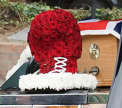 © licensed to London News Pictures. 18/05/2011. Tonbridge, UK. A boxing glove made of flowers at the funeral of heavyweight boxing legend Sir Henry Cooper arriving at Corpus Christi Church in Lyons Crescent, Tonbridge, Kent today (18/05/2011).  Please see special instructions for usage rates. Photo credit should read Ben Cawthra/LNP