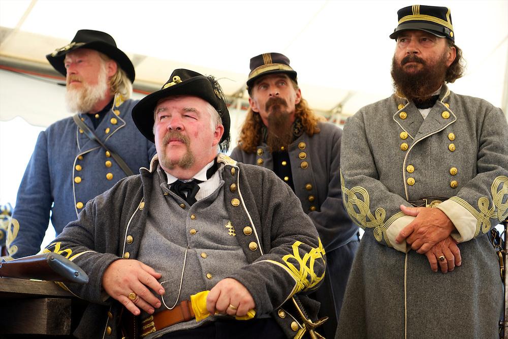Reenactors portraying Confederate generals speak during a presentation by General Robert E. Lee during the 149th Gettysburg Reenactment in Gettysburg, Pennsylvania on July 6, 2012.