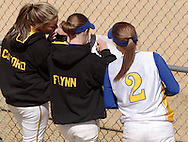 Middletown, NY - Two Gloucester County College women's softball players watch another player, at center, keep score during a game against SUNY Orange on March 29, 2008.