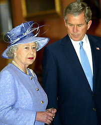 Queen Elizabeth II accompanies America's President George Bush as they enter the Queen's Gallery at Buckingham Palace, at the start of the President's state visit to Britain. Later, Mr Bush was going on to make a speech at the Banqueting Hall in Whitehall and visit the US Embassy.